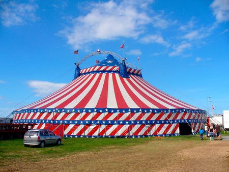 big top: Circus big top tent in field decorated with stars and stripes. Stock Photo