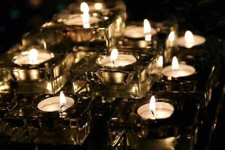 glows: Close up of romantic tea light candles, romantic scene. Stock Photo