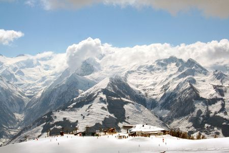 station ski: Scenic view of winters landscape of Swiss Alps mountains by ski station, Switzerland.