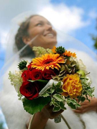 A portrait of a bride pictured on her wedding day holding bouquet, focus on bouquet. Stock Photo - 3962948