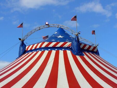 Exterior view of top of American circus big top marquee tent, decorated with United States on America flag.  photo