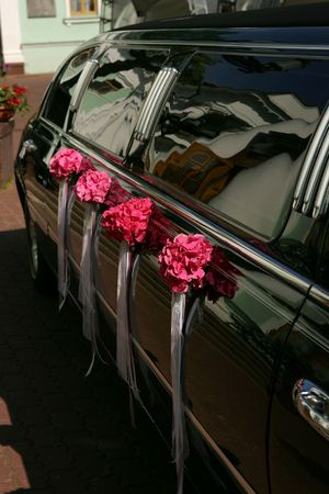 Luxurious black stretch limousine decorated with flowers photo