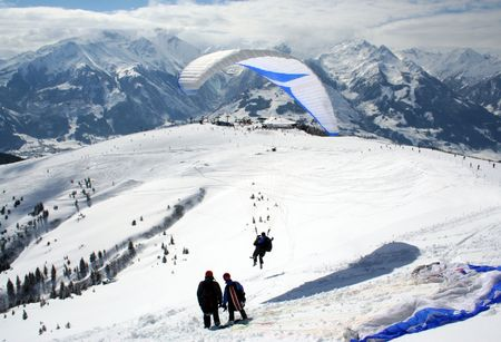 austrian: Rear view of tandem parascenders in Austrian Alps, Zell am Zee, Austria. Stock Photo
