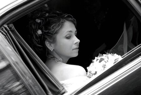 Bride in wedding car limousine photo