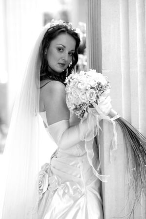 Side portrait of young bride holding bouquet of flowers. Stock Photo - 5507717