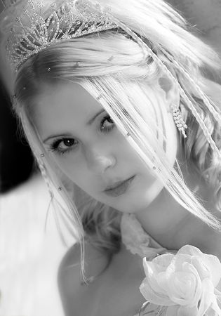image created 21st century: Portrait of beautiful young blond haired bride on wedding day wearing tiara.