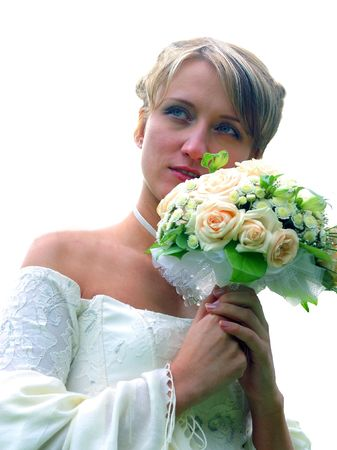 Young adult bride holding bouquet of flowers, isolated on white background. Stock Photo - 5507719