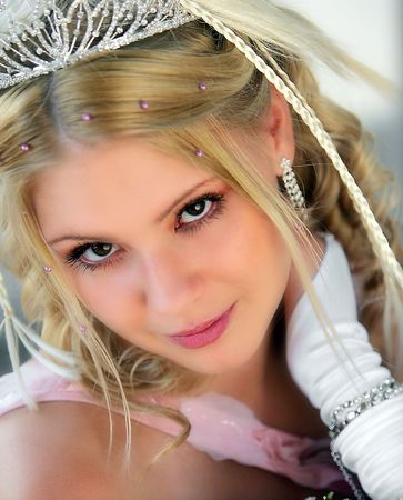 Portrait of smiling young adult bride wearing tiara. photo