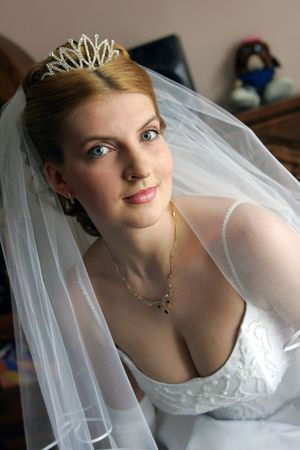 Portrait of auburn haired bride in tiara on wedding day. photo