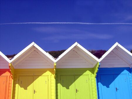 Low angle view of colorful wooden beach chalets in seaside resort of Scarborough, North Yorkshire, England.