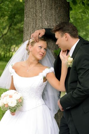 Three quarter body portrait of happy young couple looking lovingly at each other in forest. Stock Photo - 5974032