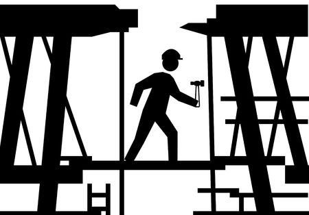 Silhouetted on workman with hammer on building site scaffolding. photo