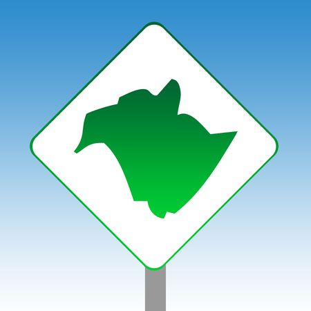 Canadian state of New Brunswick map road sign in green isolated on white with blue sky background. photo