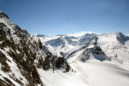 mountainous: Scenic view of snow covered mountainous Alpine landscape in Winter. Stock Photo