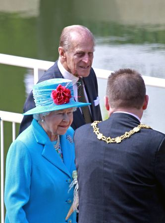 royal: SCARBOROUGH, ENGLAND - MAY 20: Her Royal Highness Queen Elizabeth II, Prince Phillip Duke of Edinburgh and local mayor Bill Chatt at opening of Royal Open Air Theater, Scarborough, North Yorkshire, England.