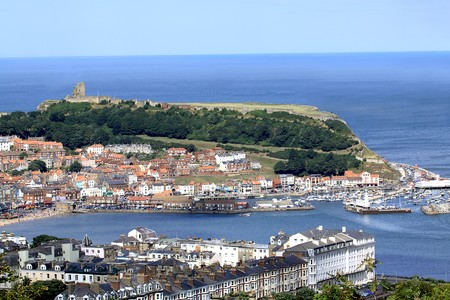 Aerial view of Scarborough town harbor and castle, North Yorkshire, England.