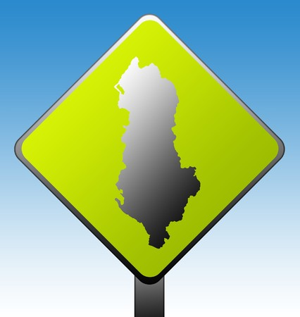 Black silhouetted map of Albania on green diamond shaped road sign with gradient blue sky background. photo