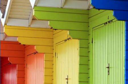 Row of colorful beach chalets or huts, abstract background. photo