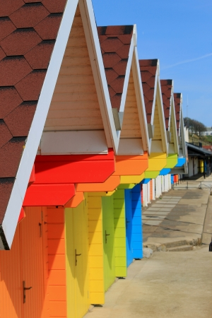 Row of colorful beach huts or chalets with blue sky background and copy space. Stock Photo - 13706605