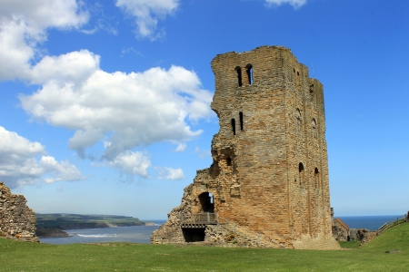 norman castle: Scenic view of ruins of Scarborough Castle with blue sky and cloudscape background, North Yorkshire, England.