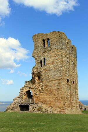 norman castle: Scenic view of ruins of Scarborough Castle with blue sky and cloudscape background, North Yorkshire, England