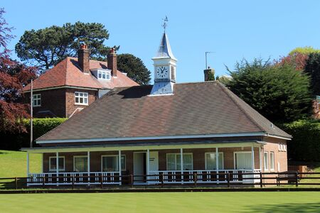 Traditional English bowling green pavilion building in summer. photo