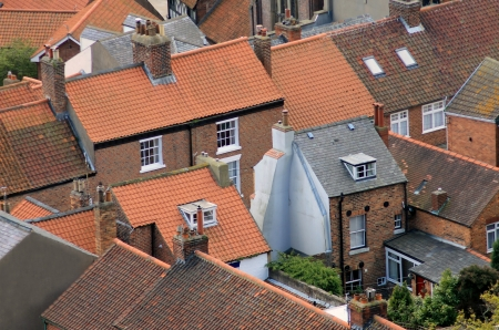 terraced: Aerial view of urban housing showing rooftops. Stock Photo