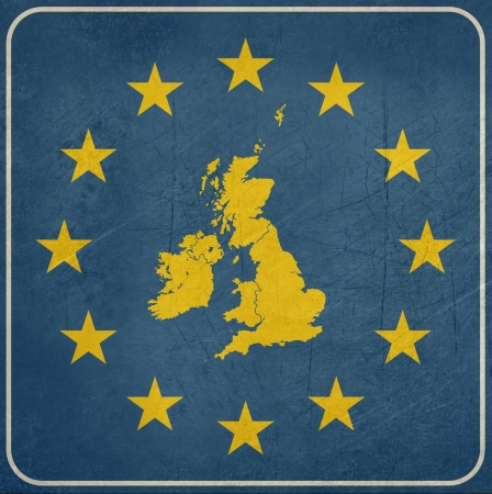 eire: Grunge UK map on blue and starry European button isolated on white background with copy space.