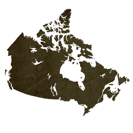 silhouetted: Dark silhouetted and textured map of Canada isolated on white background. Stock Photo