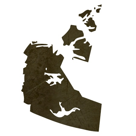 territories: Dark silhouetted and textured map of Northwest Territories province of Canada isolated on white background.