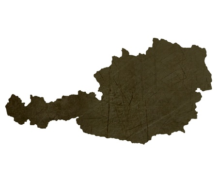silhouetted: Dark silhouetted and textured map of Austria isolated on white background.
