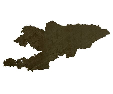 silhouetted: Dark silhouetted and textured map of Kyrgyzstan isolated on white background.