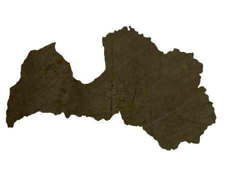 silhouetted: Dark silhouetted and textured map of Latvia isolated on white background.
