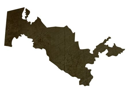 uzbekistan: Dark silhouetted and textured map of Uzbekistan isolated on white background. Stock Photo