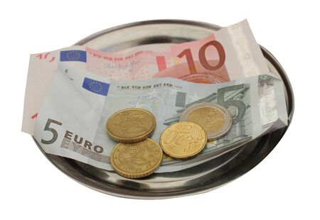 denominational: Closeup of European banknotes and coins on metal tray, white background. Stock Photo