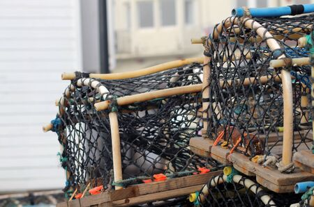lobster pots: Lobster pots and creels with building in background and copy space.