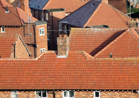 typically english: Red tiles on house roofs in English housing estate, Scarborough.