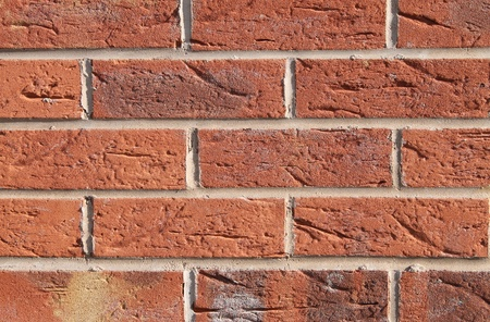 Background of new red brick wall. Stock Photo
