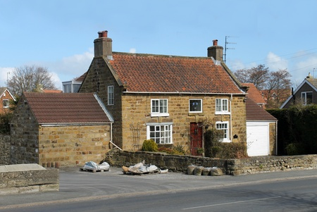 cottage house: Exterior of modern house or cottage in countryside, Burniston, England.