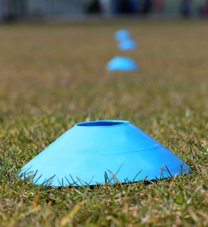 recedes: Sports training cones on soccer or football pitch Stock Photo