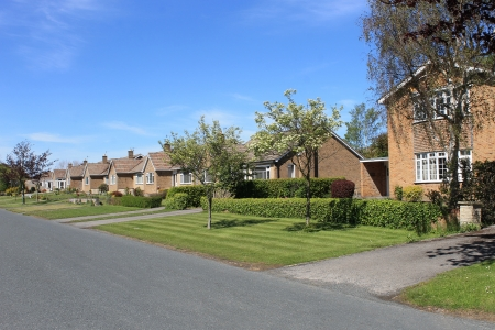 Row of houses and bungalows on English street in rural village. photo