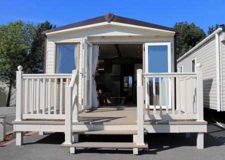 static: Exterioer of luxurious modern caravan with open doors. Stock Photo
