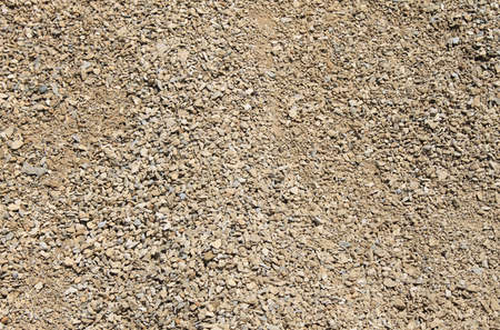 hard core: Abstract background of small stones and gravel. Stock Photo