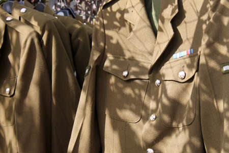 british army: British army military uniform for sale on market stall. Stock Photo