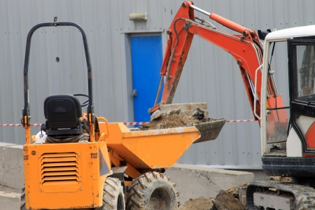 hire: Heavy plant machinery and digger on construction site.