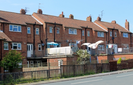 terraced: Row of English terraced houses in street.