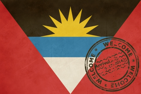 Welcome to Antigua and Barbuda flag with passport stamp. photo