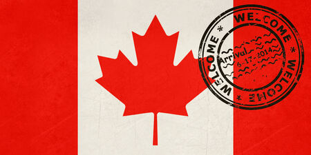 canada stamp: Welcome to Canada flag with passport stamp  Stock Photo