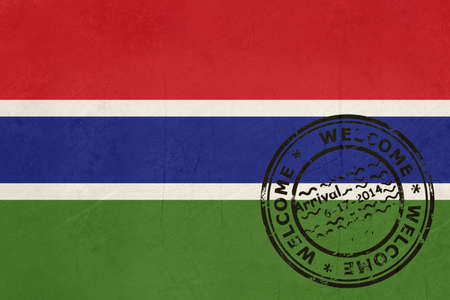 Welcome to Gambia flag with passport stamp  Stock Photo