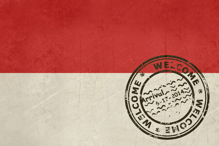 Welcome to Indonesia flag with passport stamp  photo